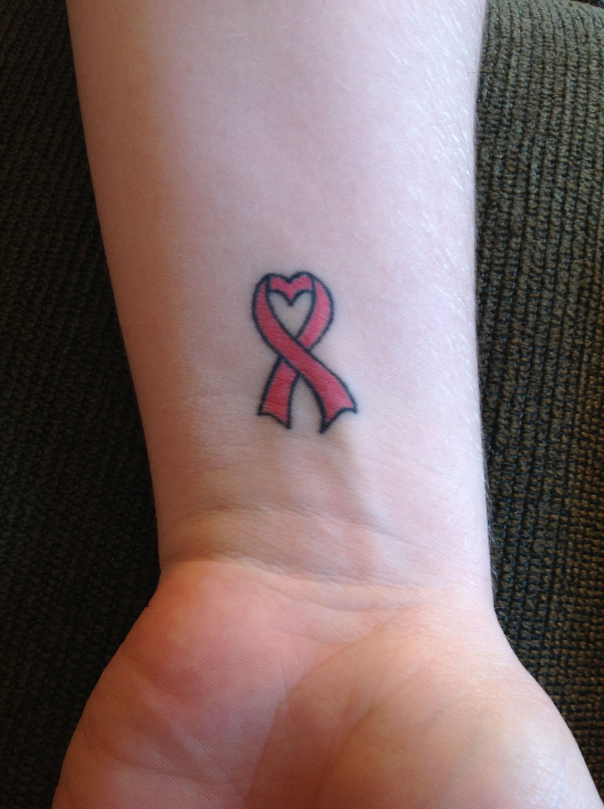 Breast cancer tattoo with a heart on the wrist health for Heart ribbon tattoo