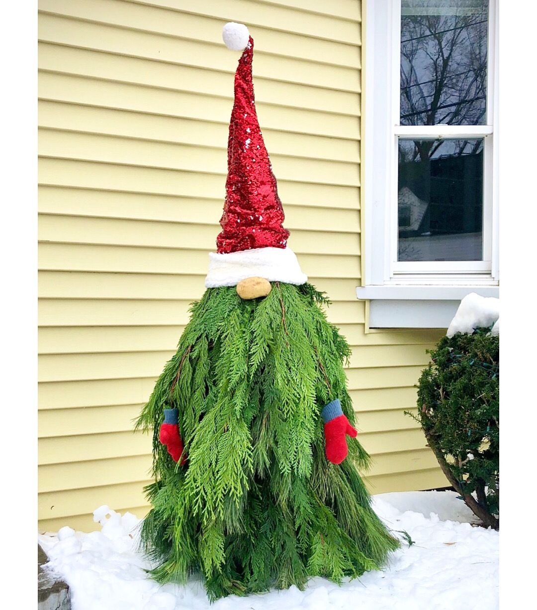 Holiday gnome made from some greens, a tomato cage and