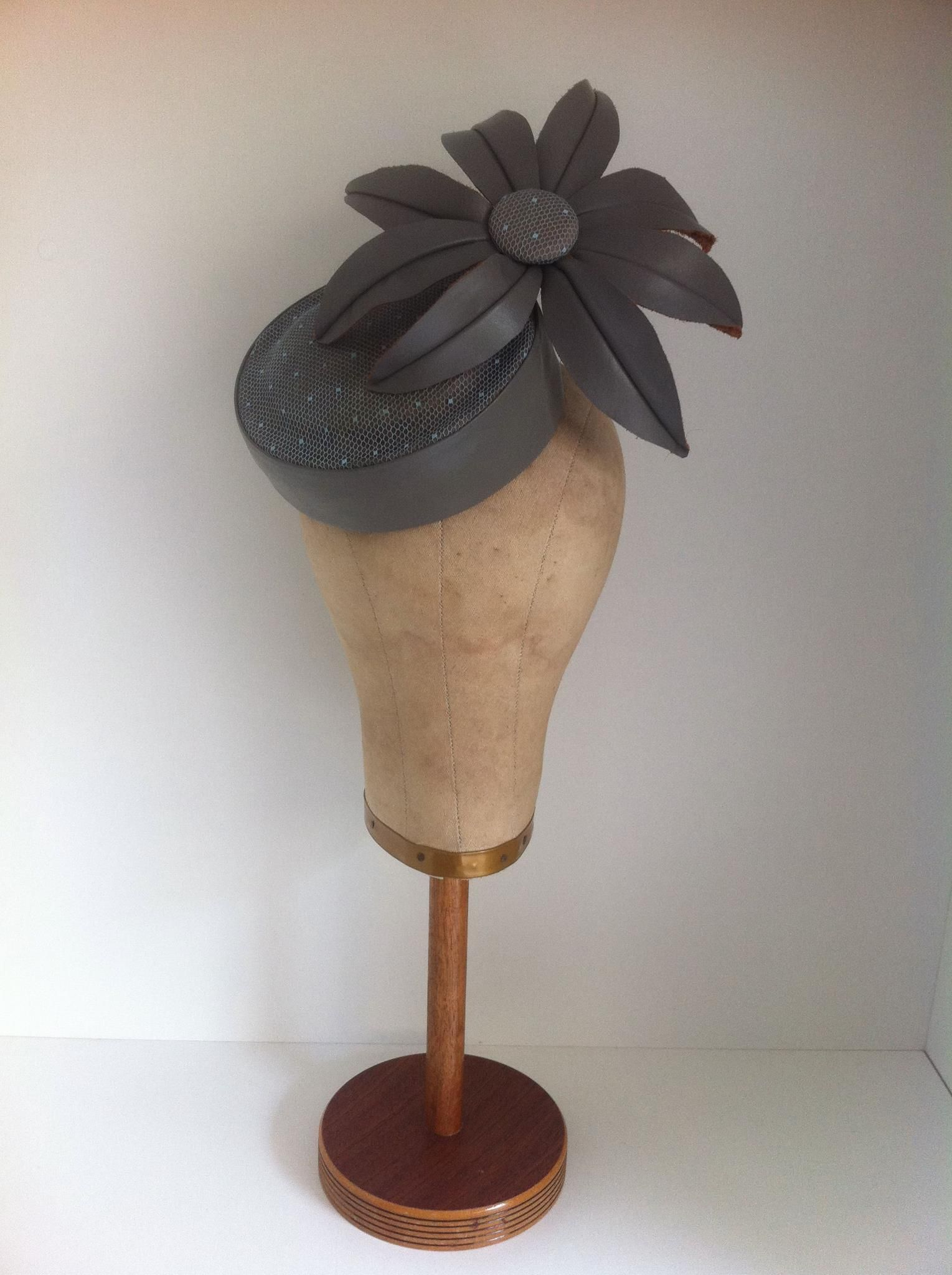 Grey leather daisy headpiece by Murley & Co Millinery. $240 inc hatbox.   Features a layer of blue vintage veiling on the recessed cocktail button & covered button... Leather is a beautiful material to work with AND wear and styles like this one can be recreated in any colour combination...  just ask ;)  www.murleyandco.com www.facebook.com/murleyandcomillinery