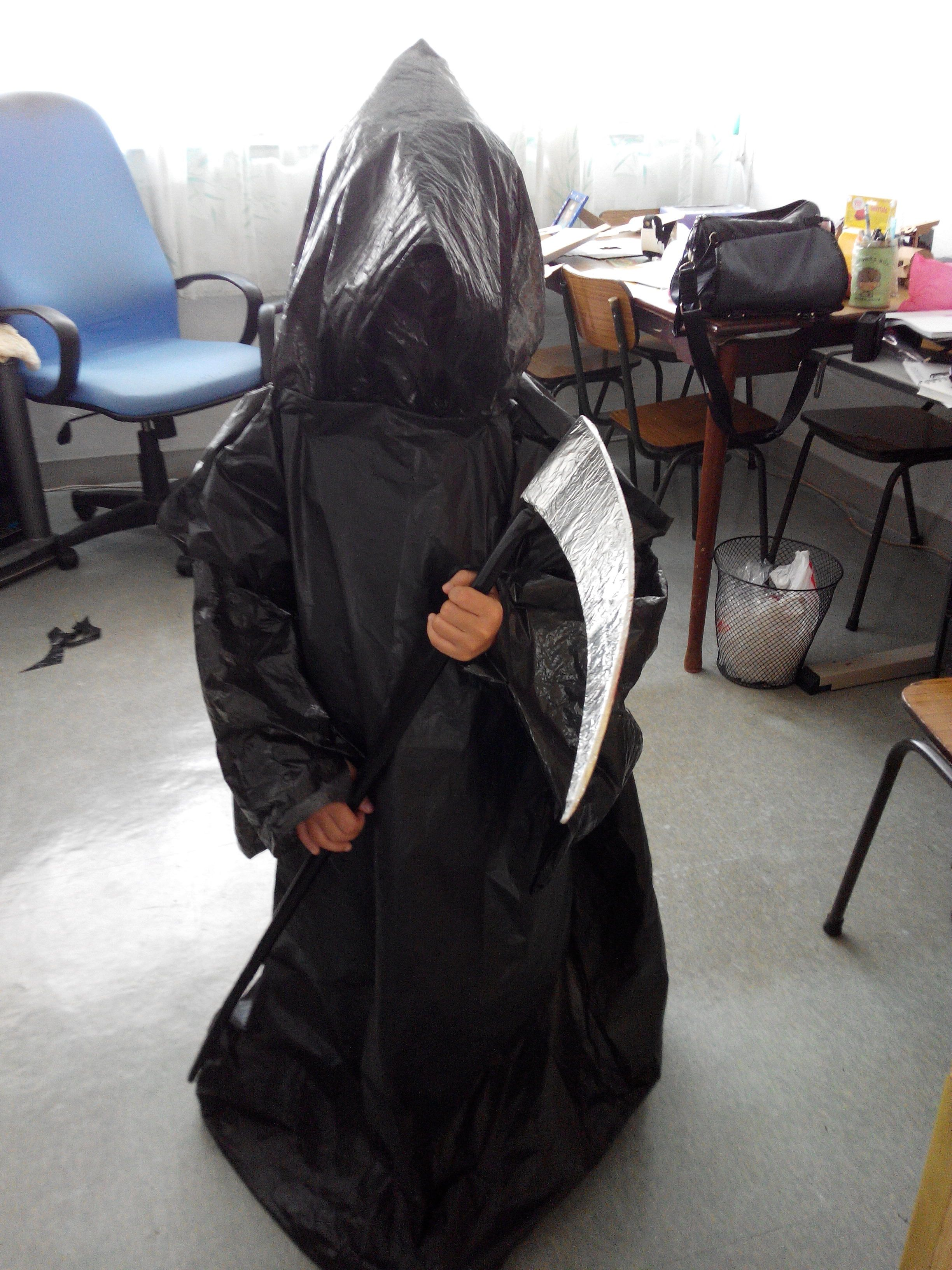 Grim reaper costume. Made from trash bags. Scythe made from