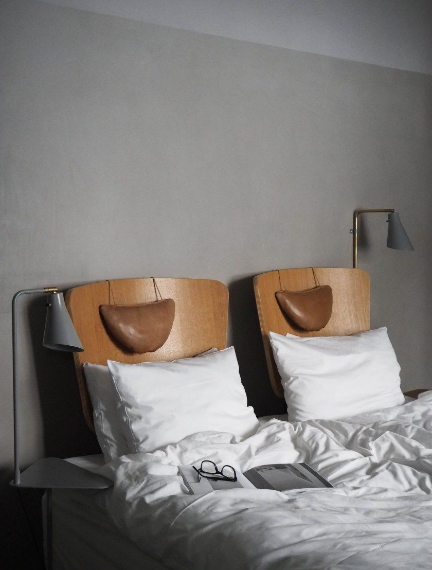 Grey walls and wooden headboards at SP34 boutique hotel in Copenhagen