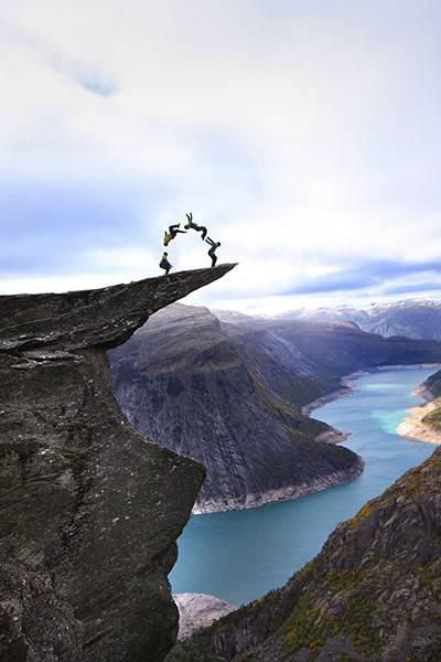 Daredevils perform stunts on Troll's Tongue in Norway – in ...