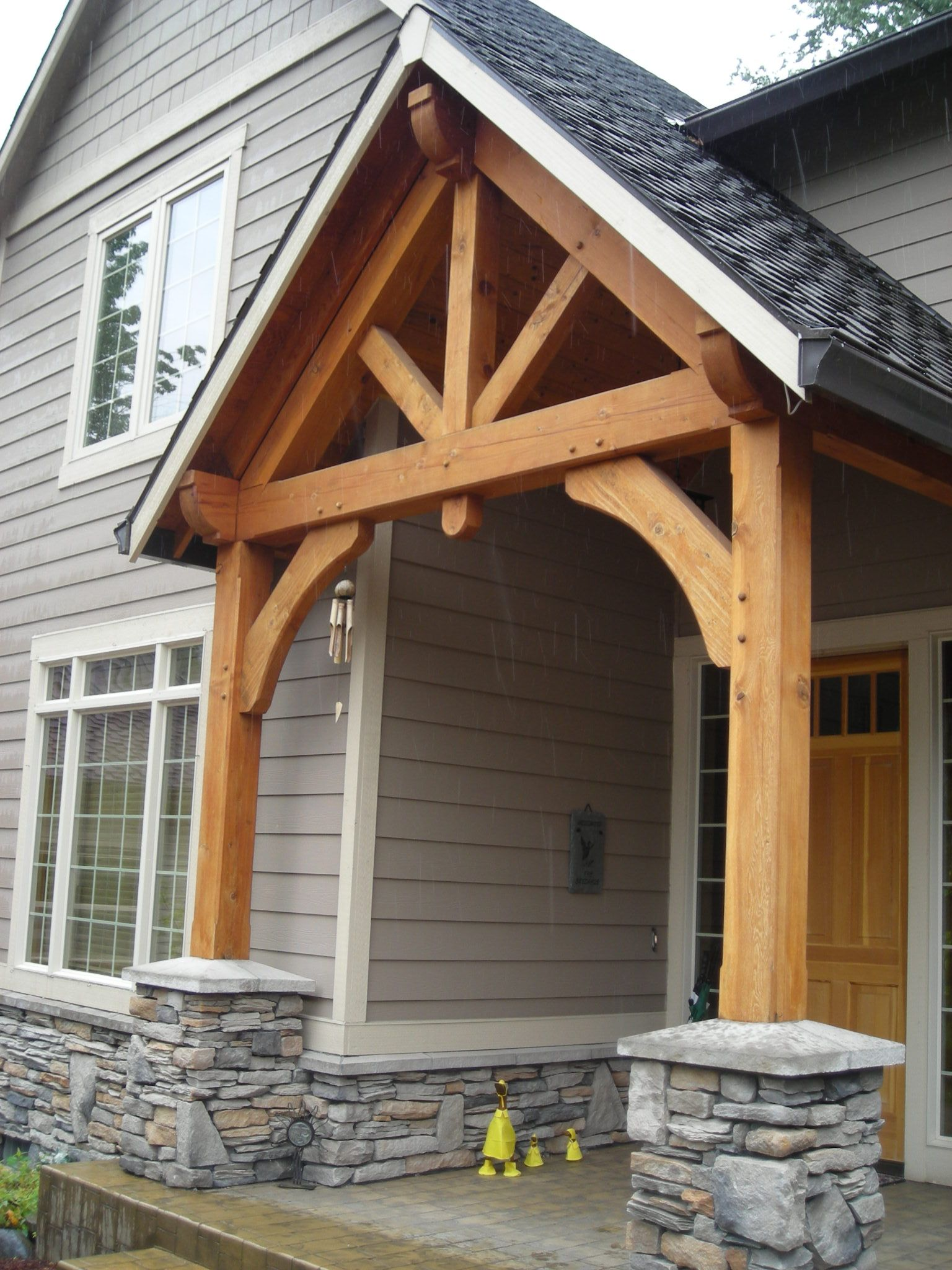 Timber frame entry timber frame entry pinterest for Front door roof designs