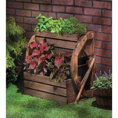 Wagon Wheel Double-Tier Planter.  Add a fresh touch of the country, complete with greenery, and enjoy your garden in a whole new way! Double-level planter features a quaint wagon wheel theme and rustic finish, with plenty of room to proudly show off your favorite blooms.  #planter #planters