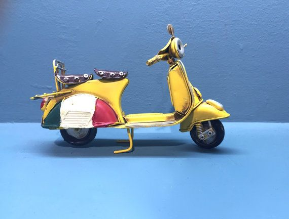 Vintage yellow Italian scooter vespa miniature, decorative collectible, retro collection