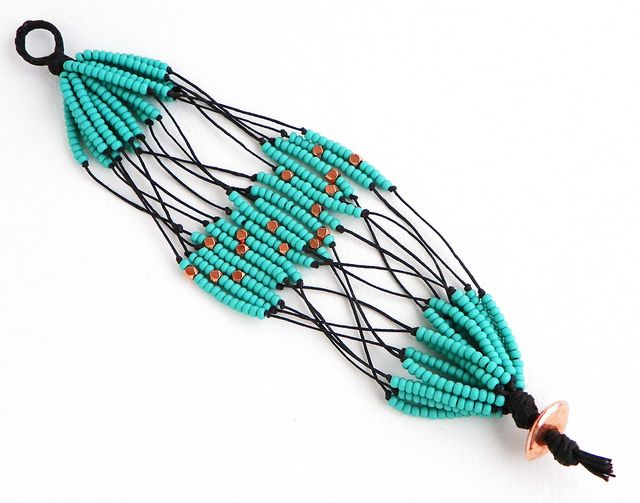 pretty pretty!    African-inspired beaded cuff by Erin Siegel Jewelry, via Flickr