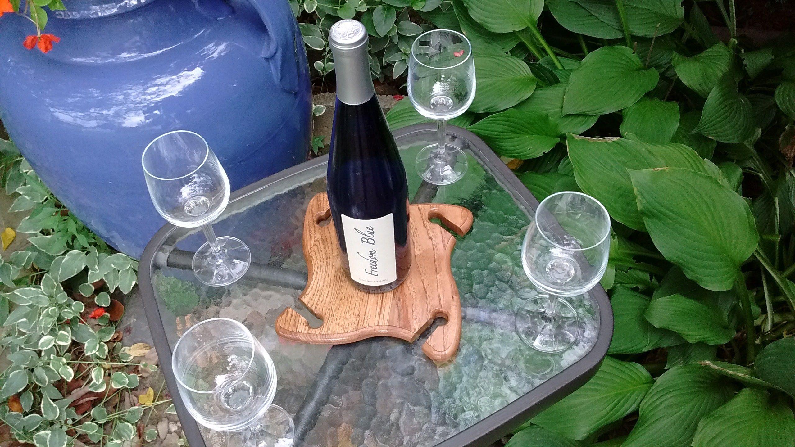 https://www.etsy.com/shop/ChestnutHillWorkshop?ref=hdr_shop_menu Over the bottle wine glass holder.  Wine bottle holder