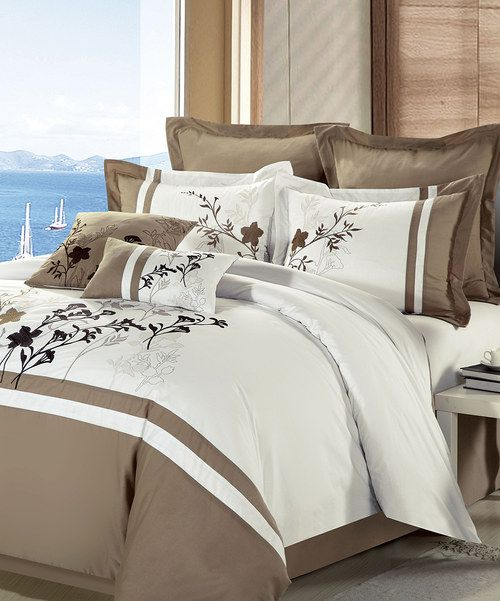 Classically elegant, this luxurious comforter set is ready to instantly transform bedroom décor. With exquisitely detailed embroidery in natural hues, it's sure to create a cozy bedroom atmosphere ready for rest and relaxation.Eight-piece set includescomforter, bed skirt, two shams, throw pillow, breakfast pillow and two euro shams12-piece set includes comforter, bed skirt, two shams, two throw pillows, two breakfast pillows, white flat sheet, white fitted sheet and two white standard pillow…