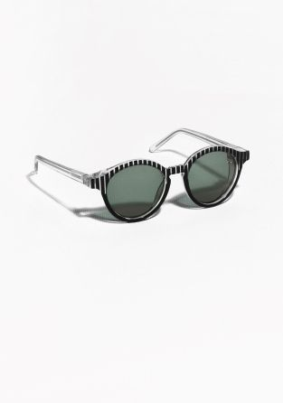 Robust see-through frames with a tactile stripe pattern at front define these round sunglasses with a sharp and graphic look.   Read more about our sunglasses  here.