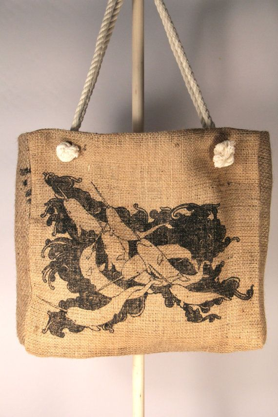 This tote is made from a recycled coffee bean sack. It is lined with 100% cotton duck canvas and has 100% cotton rope handles. There is a divided pocket on the inside. The print on this tote was created exclusively for the green bean by artist Kerstin Bendl and is called Narwhale  The dimensions are 15 tall, 15 wide, 4 deep  It is 100% Handmade in the Heartland of America, Kansas City MO.  $1 from the sales of this tote goes to the global orphan project.  Once ordered it will be shipped USPS…