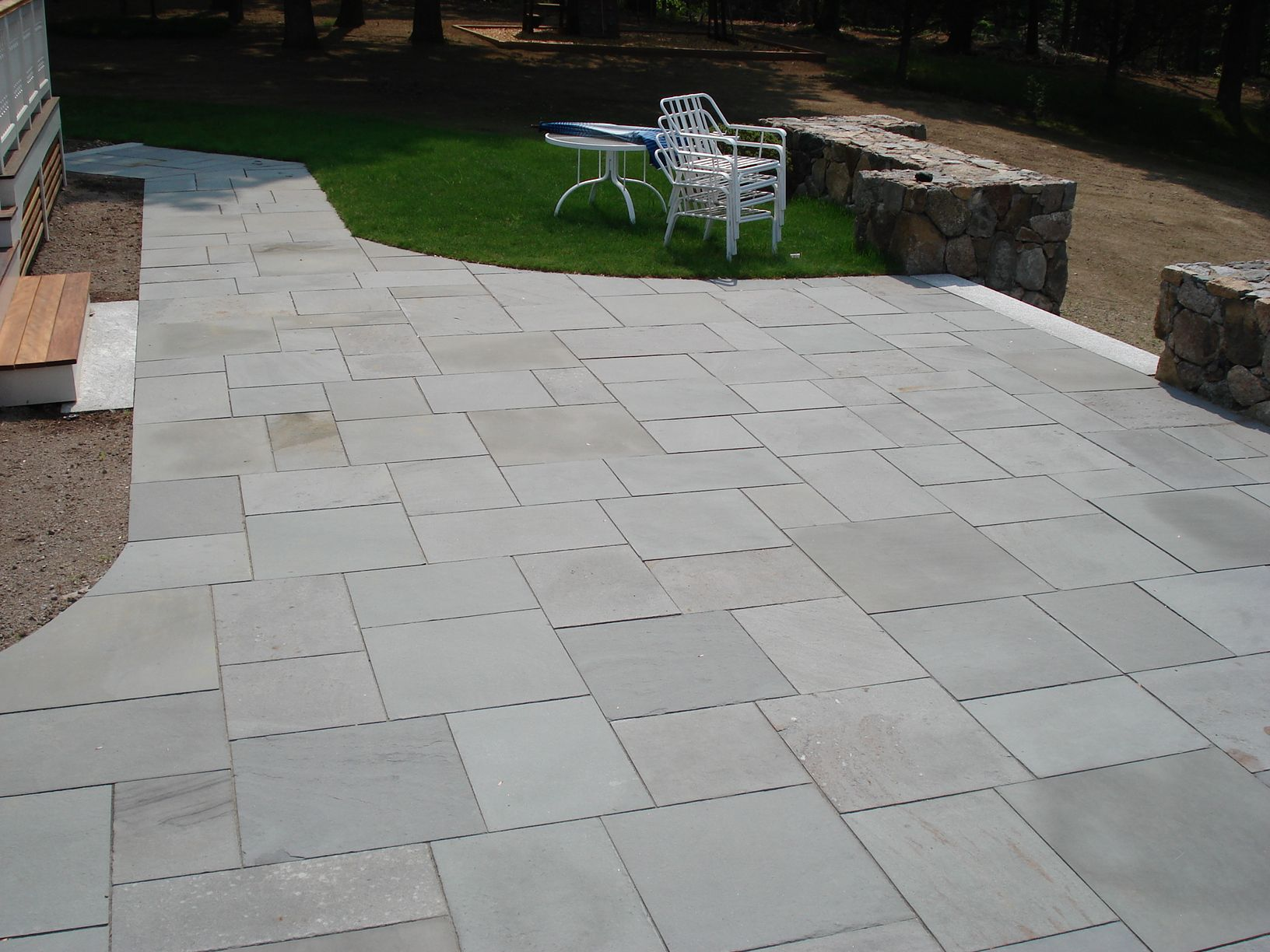 Like the neatness and shapes of the stone slabs pavers for Garden decking and slabs