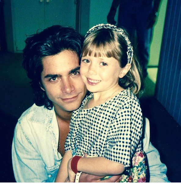 John Stamos shared this photo of himself with an adorable (and very young) Elizabeth Olsen. | 13 Celebrity #TBT Photos You May Have…
