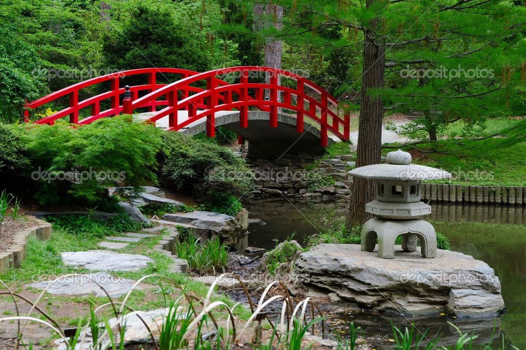 red gardens in japan red bridge in japanese garden stock image