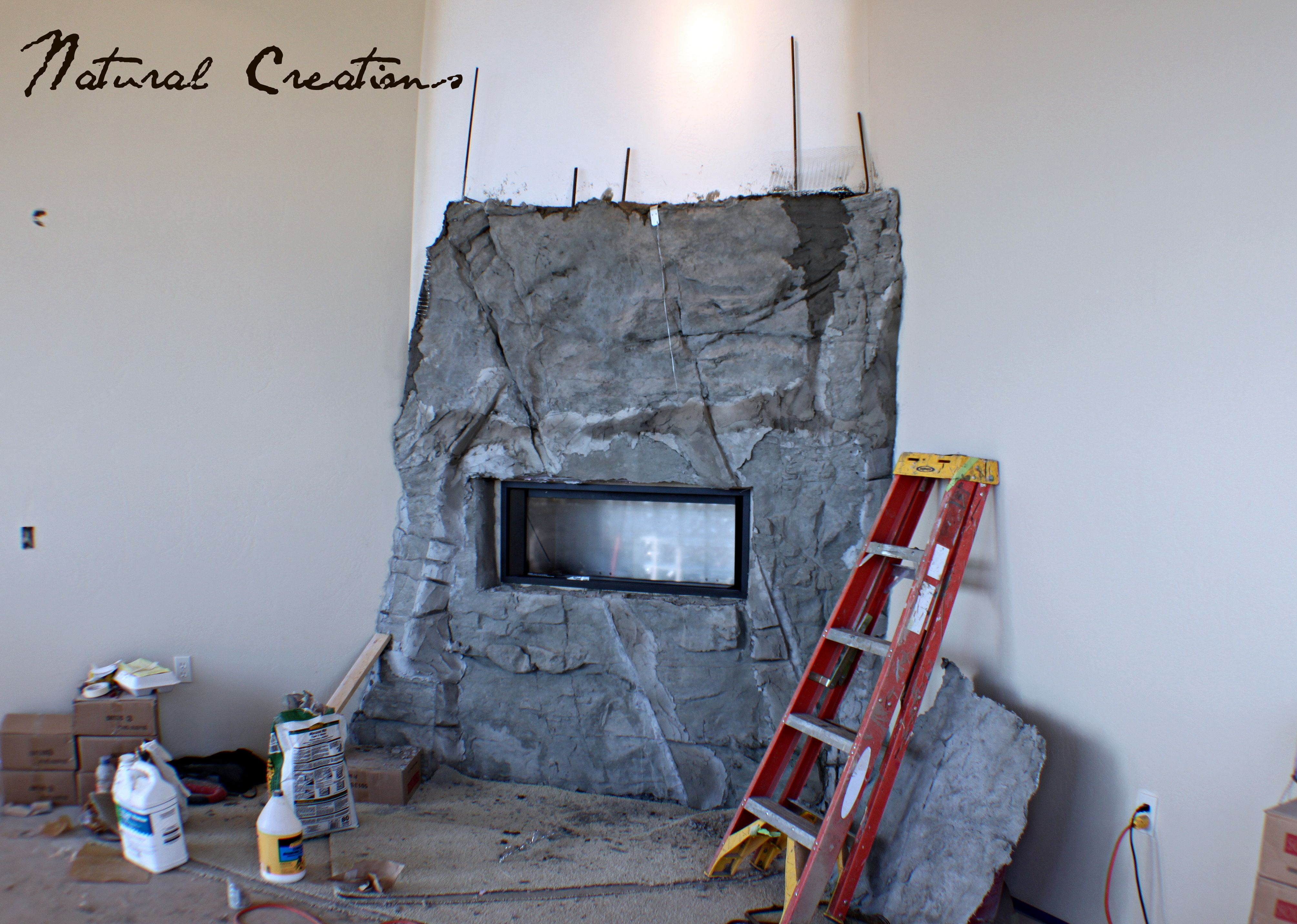 hand sculpted rock fireplace under construction for the home