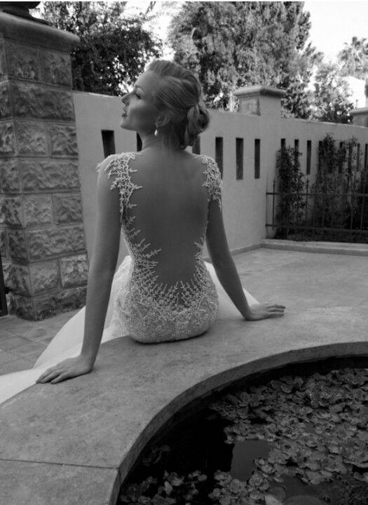 Scalloped back dress. Peekaboo  http://brides.prestonbailey.com/2012/12/11/scalloped-back-wedding-dress/