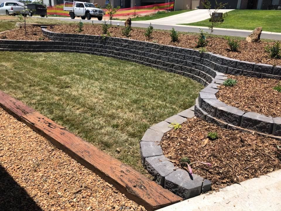 Block Retaining Wall With Split Level Planted Garden Beds Turf To