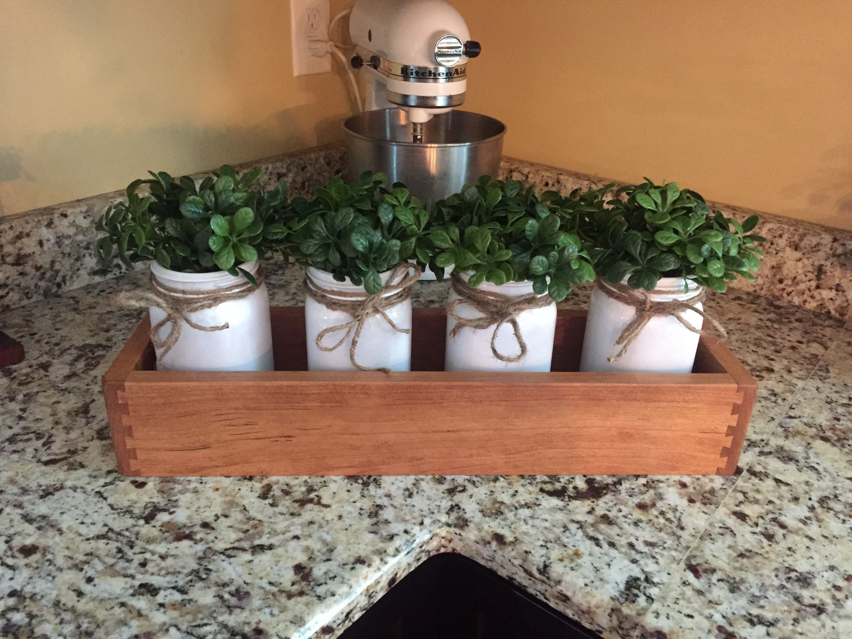 Flower box for inside   Paint mason jars and add flowers.