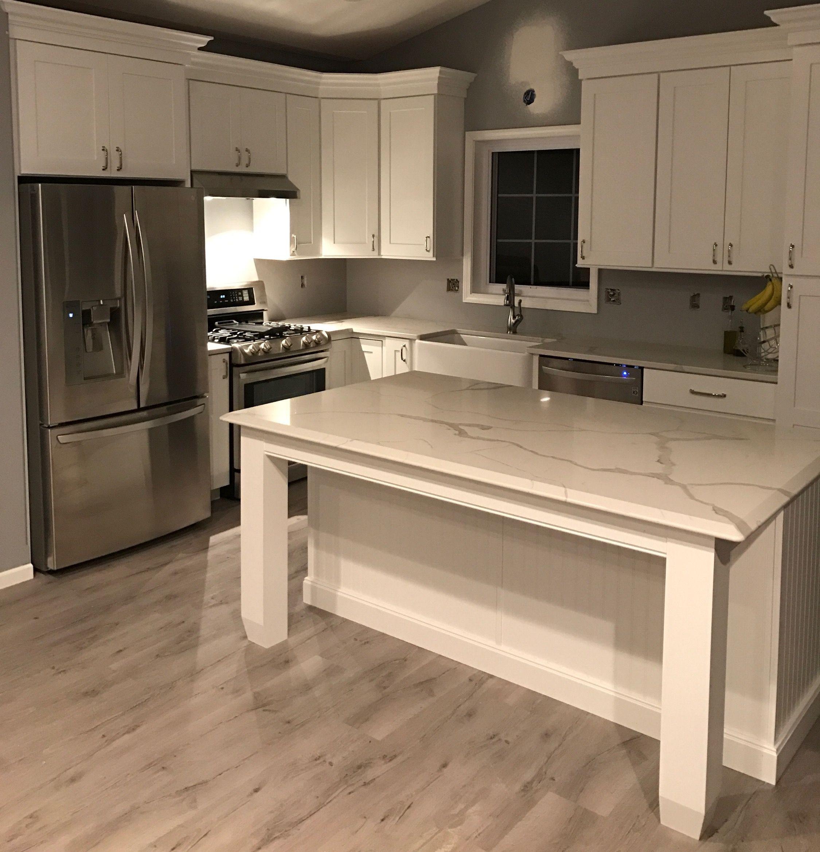 Coretec vinyl plank flooring in a light gray color House