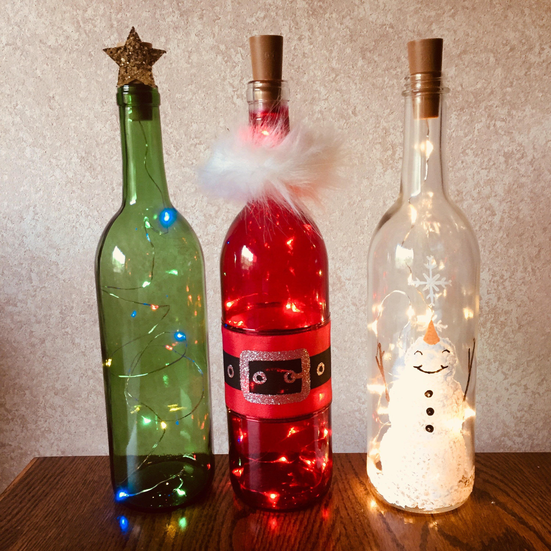 Holiday Wine Bottle Decorations With Lights Santa Snowman Christmas Tree Wine Bottle Decor Wine Bottle Crafts Holiday Decorations In 2020 Wine Bottle Decor Bottles Decoration Wine Bottle Crafts Christmas