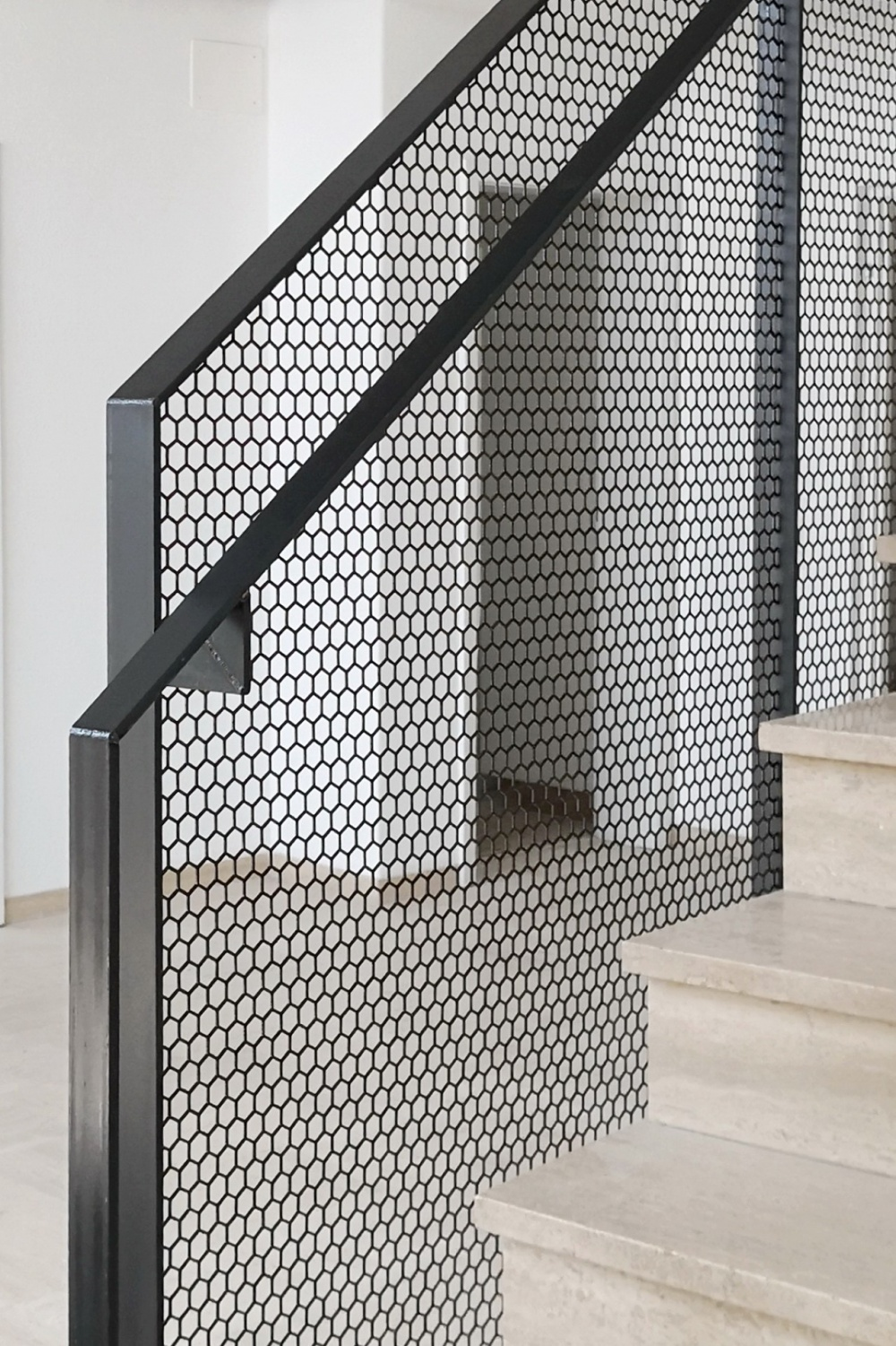 hexagonal perforated steel balustrade made by luginbuehl
