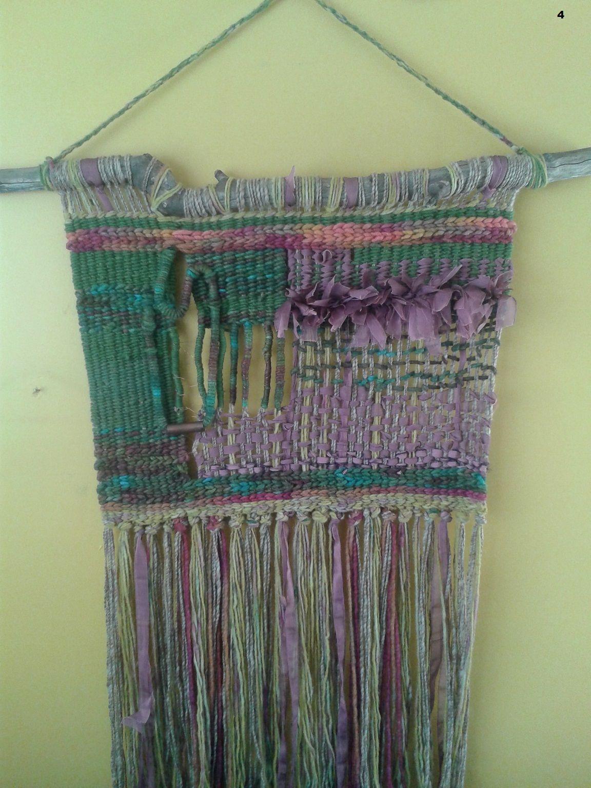 Woven wall hanging combining several techniques. I love the natural stick used as the hanger.