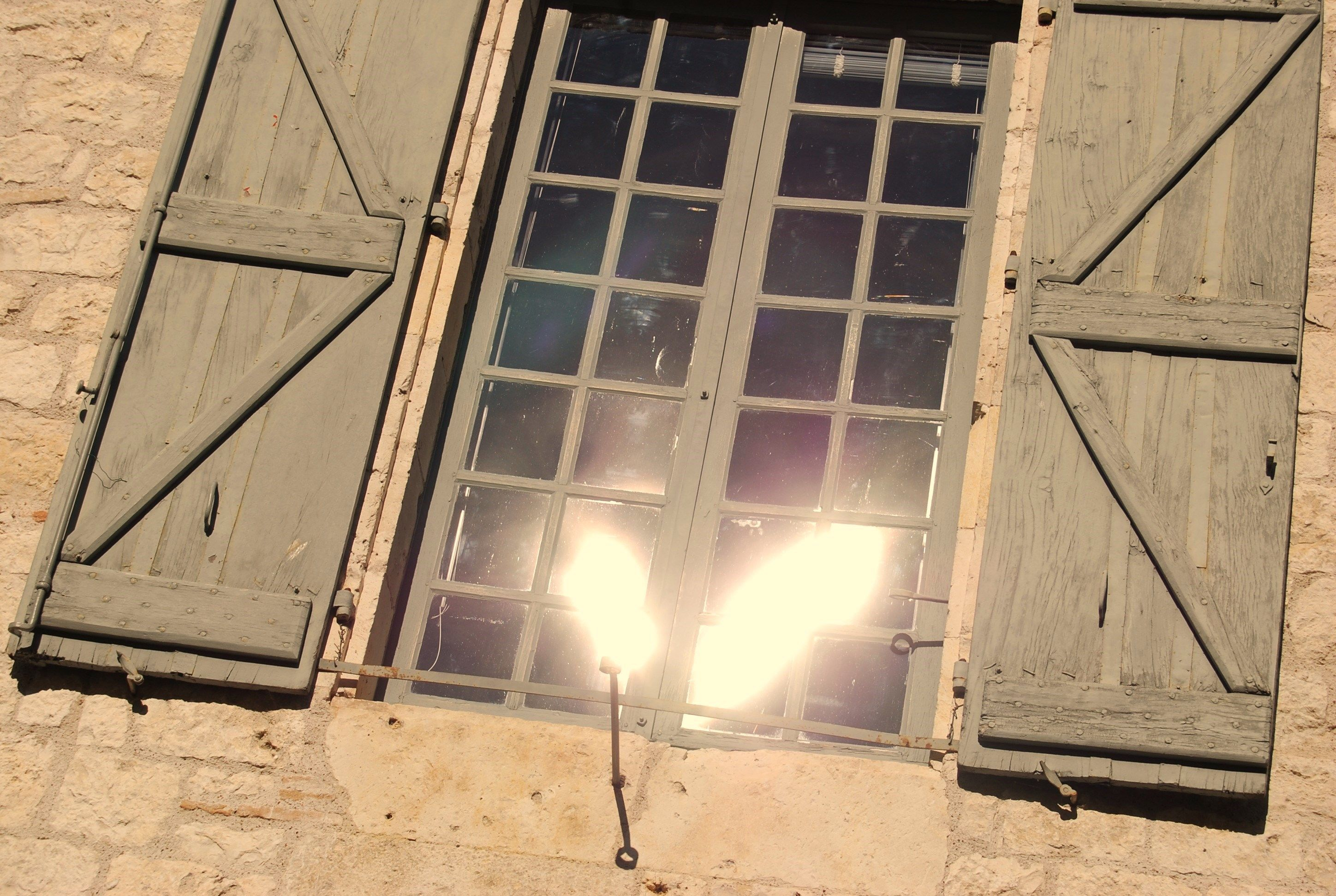 reflecting sunlight in old window