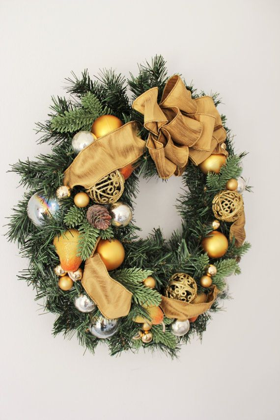 Christmas wreath with gold ribbon.  Using gold, silver, and clear color ornament.  It measures approx. 18 diameter.