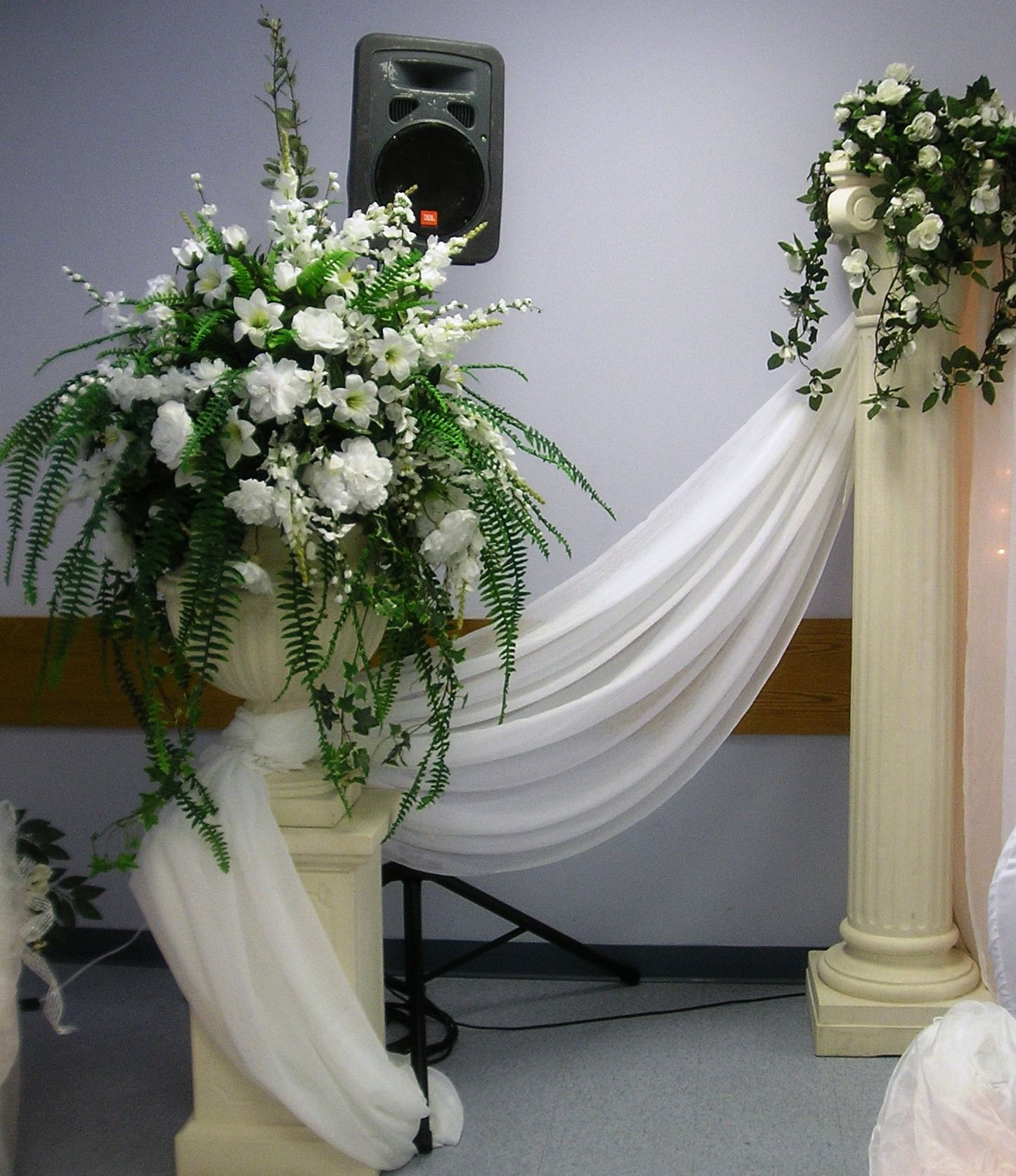 Wedding Flower Pillars: White Floral Arrangement In