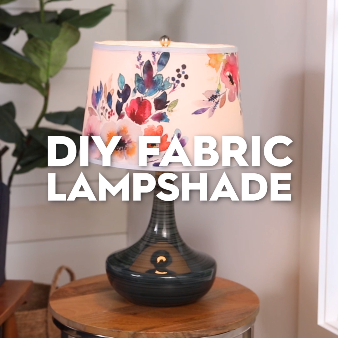 Finding the perfect lighting fixture for a room can be tough. Take matters into your own hands by crafting one yourself! Use spare fabric from curtains or find a design you love to spruce up a plain white drum shade. This easy DIY project is fun to make and even better for your wallet. Get started this weekend with our step-by-step instructions. #diyhomedecor #lampshade #decoupage #projectideas #crafts #bhg