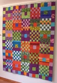 This is Kaffe Fasset. I have the book - Glorious Patchwork.
