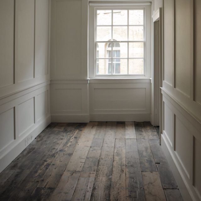 rustic floors with traditional trim details to chair rail height