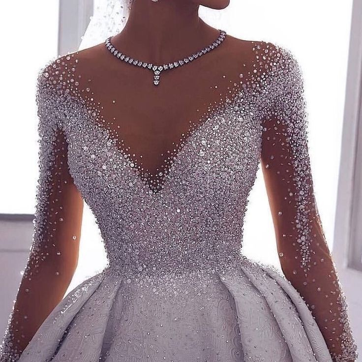 Photo of Highly embellished high fashion ball wedding dress with sleeves. Do …