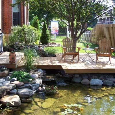Koi pond patio check out this gorgeous diy deck for Koi pond deck