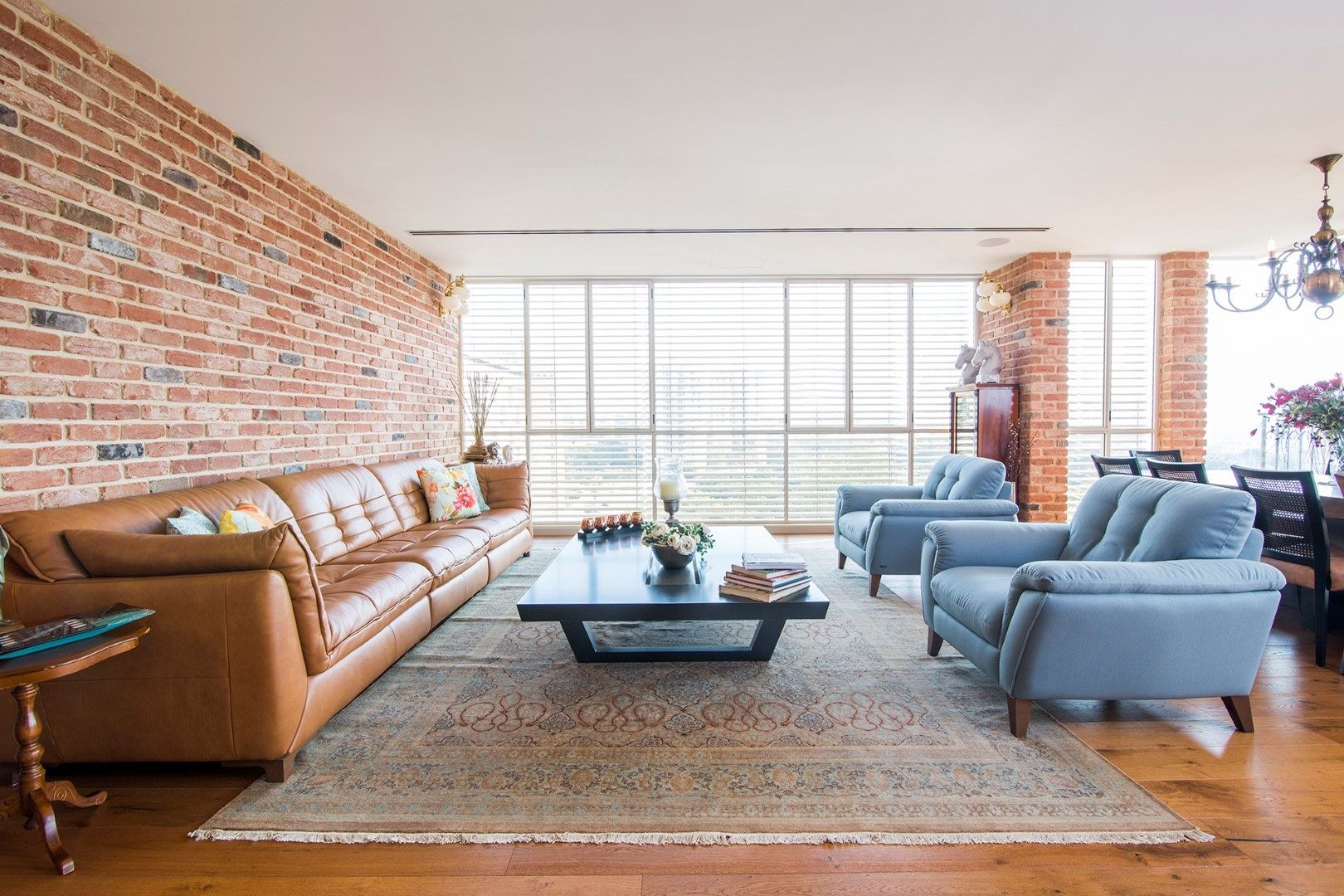 Warm country style living room with natural brick wall ...