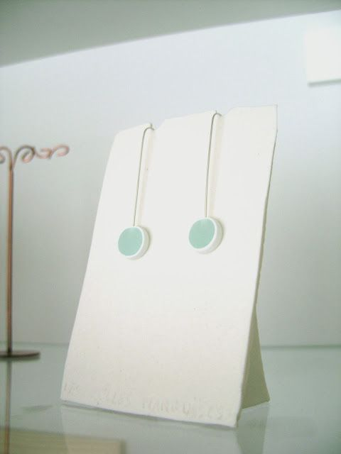 Lightdrops earrings on a porcelain stand by Les folles Marquises