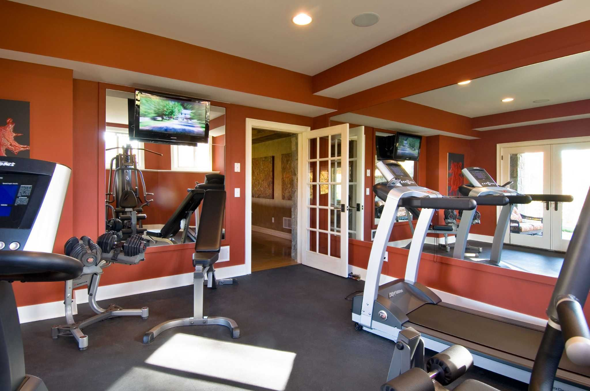 Homeowners Using Basements For A Lot More Than Breeding Dust Bunnies Workout Room Home Workout Room Design Gym Room
