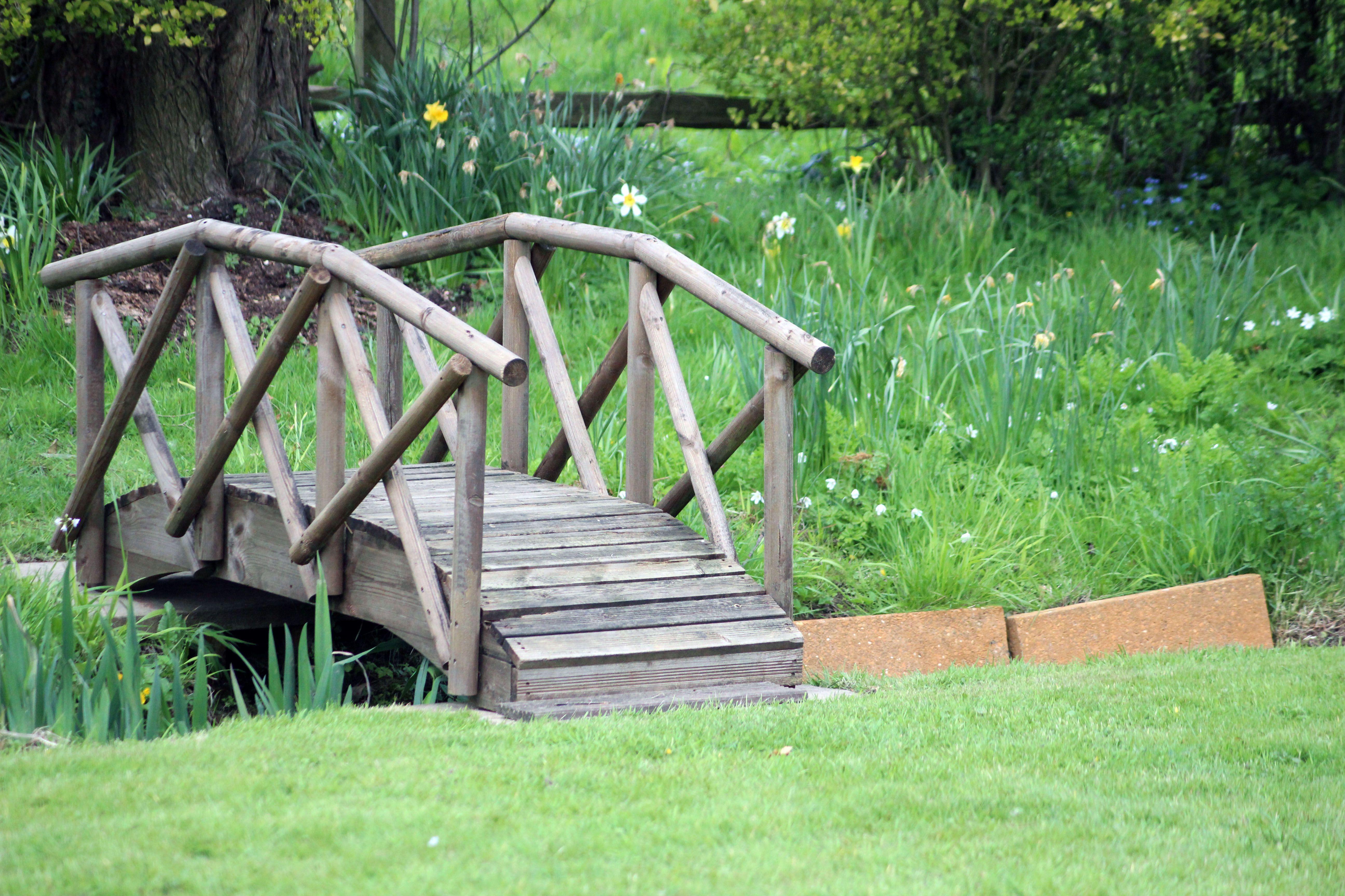 small bridge over creek yard pinterest bridge bridges and gardens. Black Bedroom Furniture Sets. Home Design Ideas