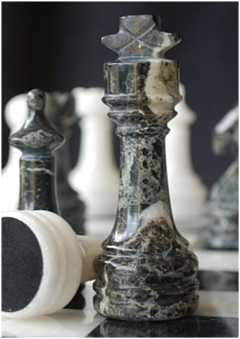 Gorgeous black marble and white onyx complete chess set with case and board. We love this one! M4000. Brought to you by ChessBaron.co.uk