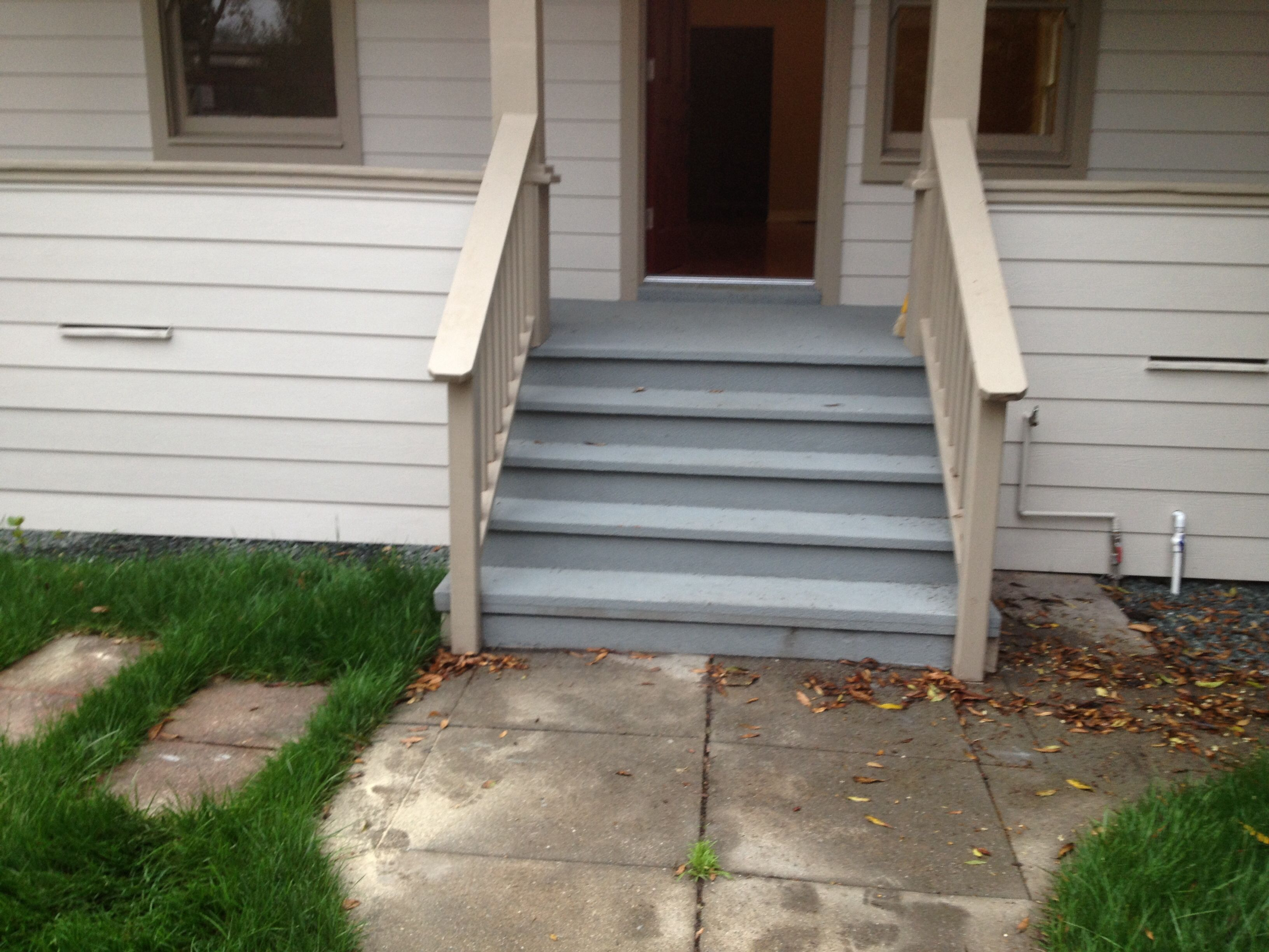 Stair rebuild with hand rails painted with grey restore recent