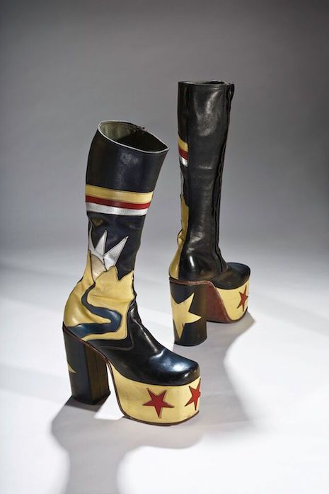 Sky-high boots and platform shoes worn