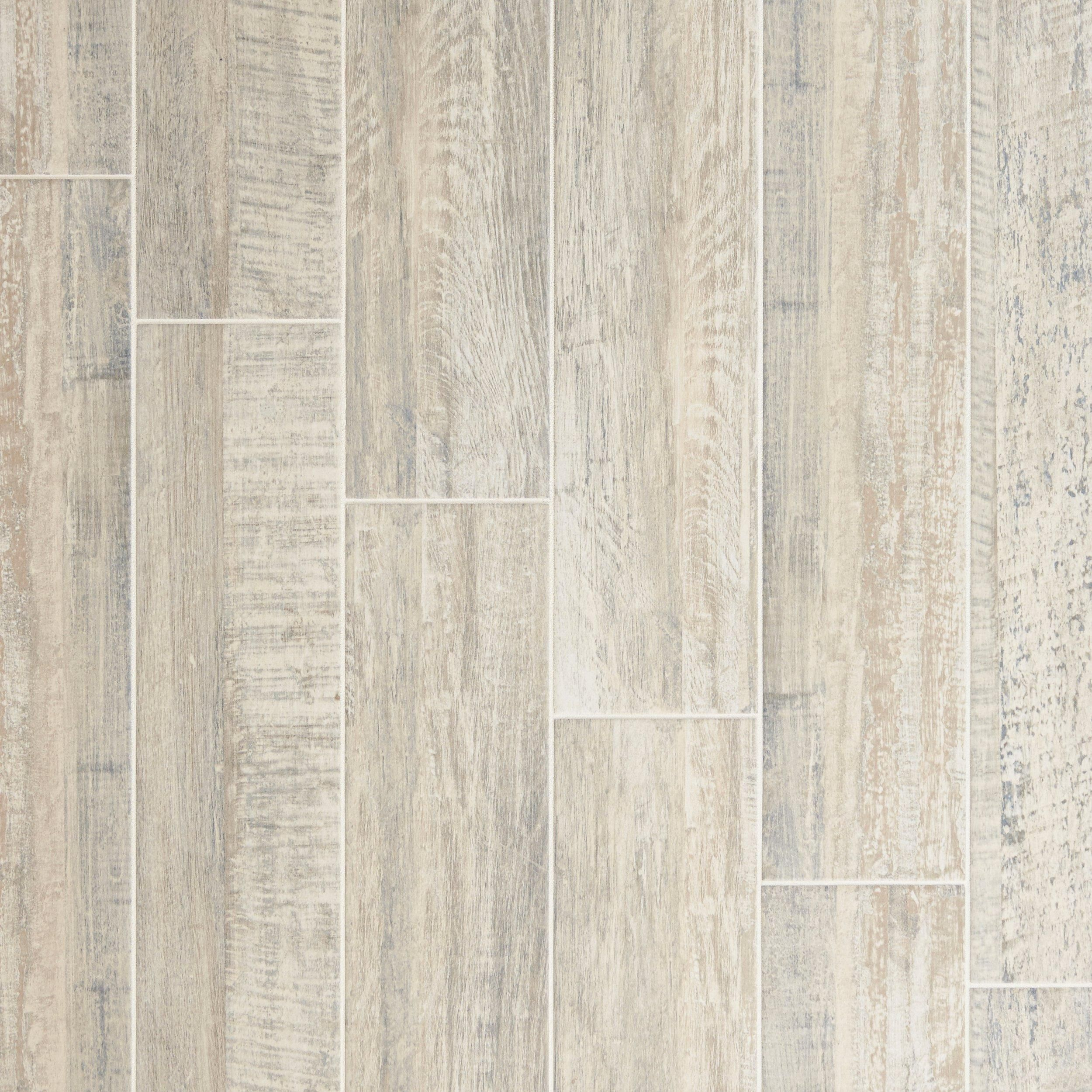 Tile but looks like wood. Can be used in the whole space including ...