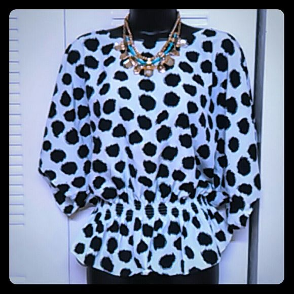Polka dot top Black and white polyester top with cinched waistline and batwing sleeves Vince Camuto Tops Blouses