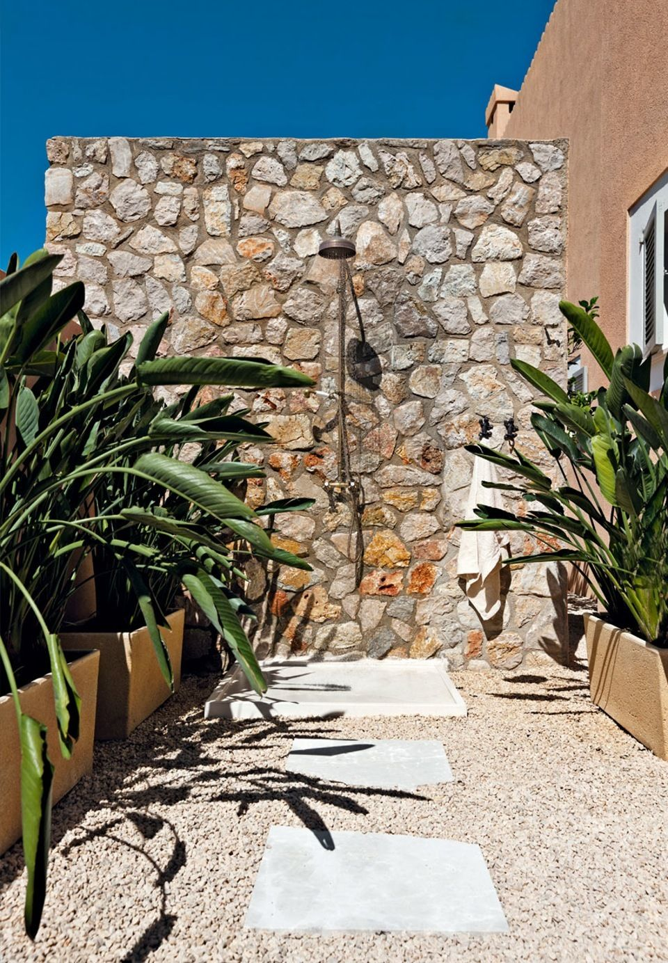 lovely and simple outdoor shower in a mallorcan backyard garden