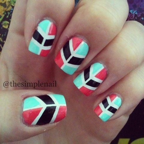 Francesca from The Simple Nail created this stellar design! She went with a tribal design by using teal, red and black!