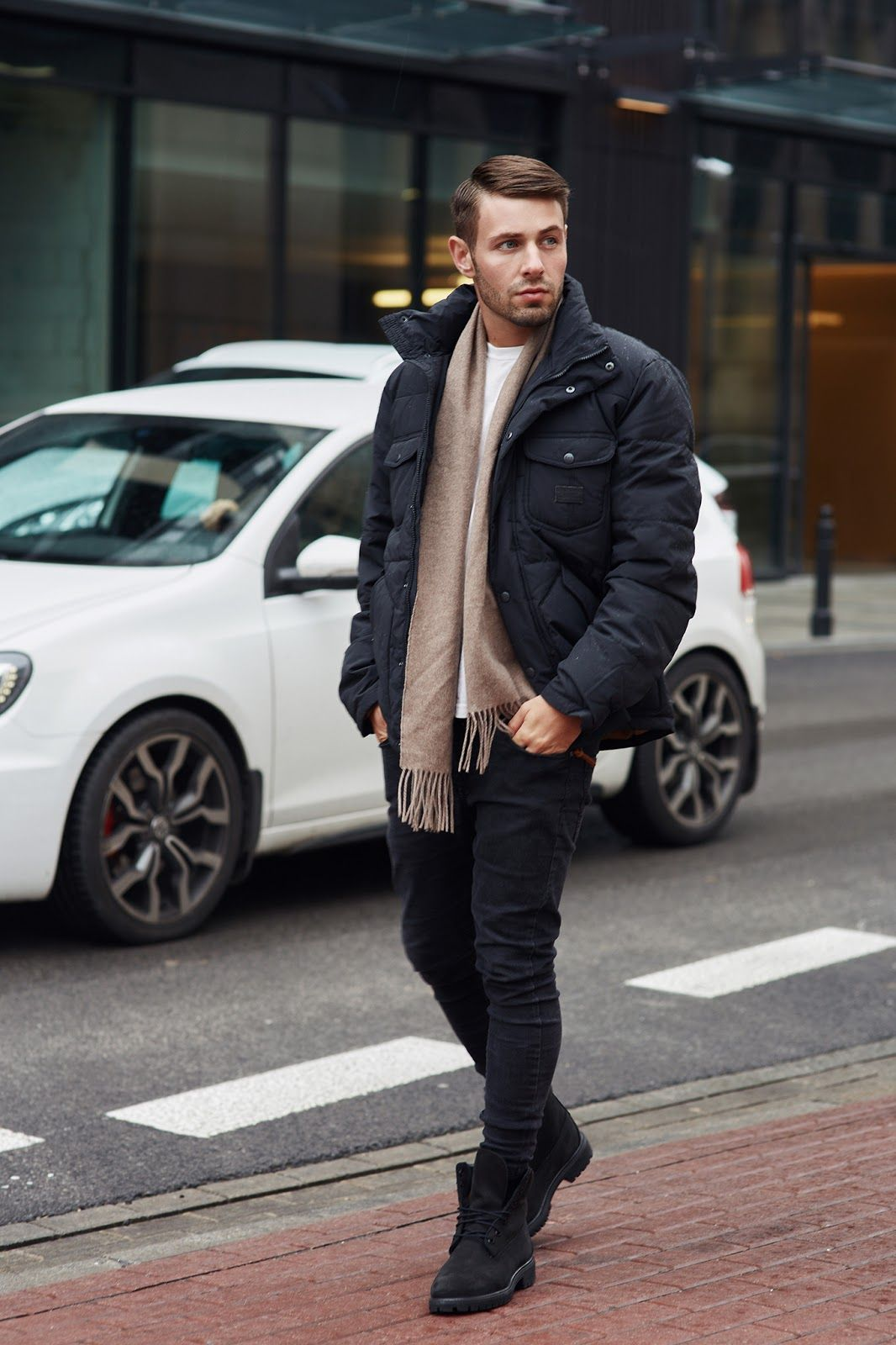 be54f5450dc Black puffer jacket + tan scarf + black skinny jeans + black boots. Find  this Pin and more on Men's Style by Trask. Tags. Timberland Black Shoes