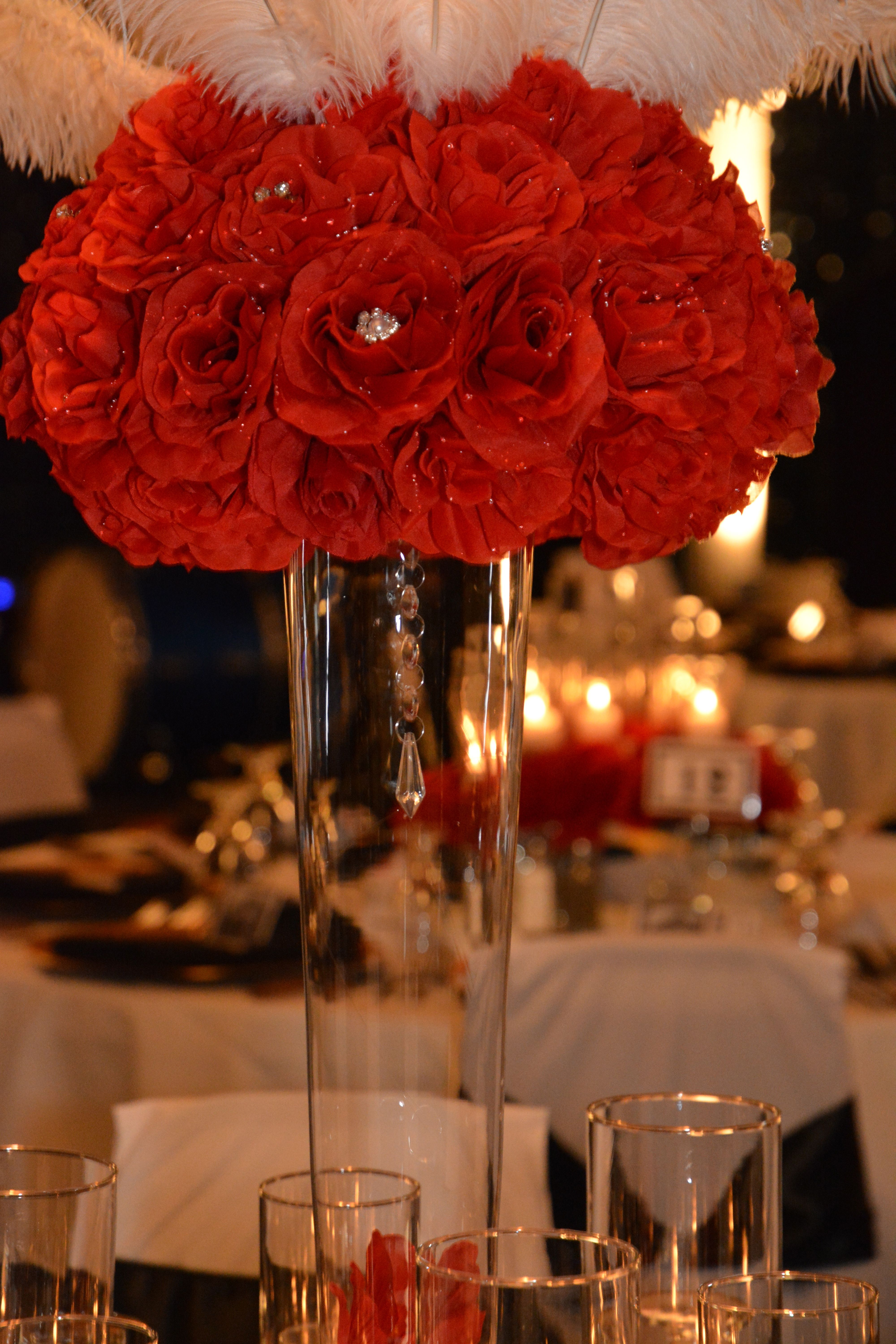 Gala decor by apaintedframe red rose feather wedding