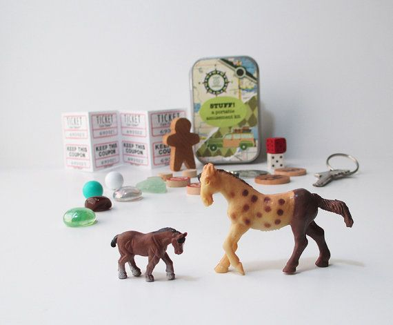 Small toys in a tin with little horses vintage game