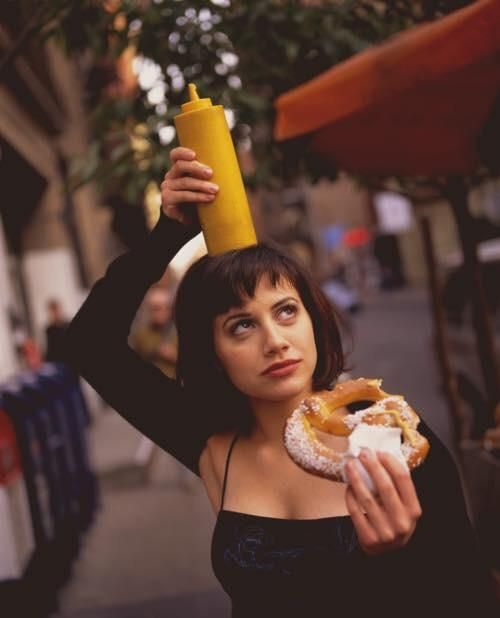 Brittany Murphy: Brittany Murphy eating a pretzel in the late 90s