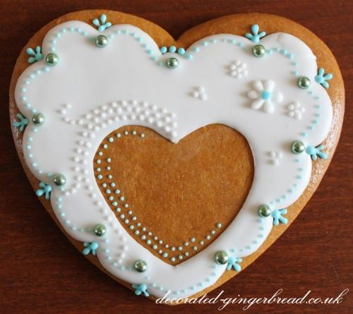 Heart with white icing and blue pearls