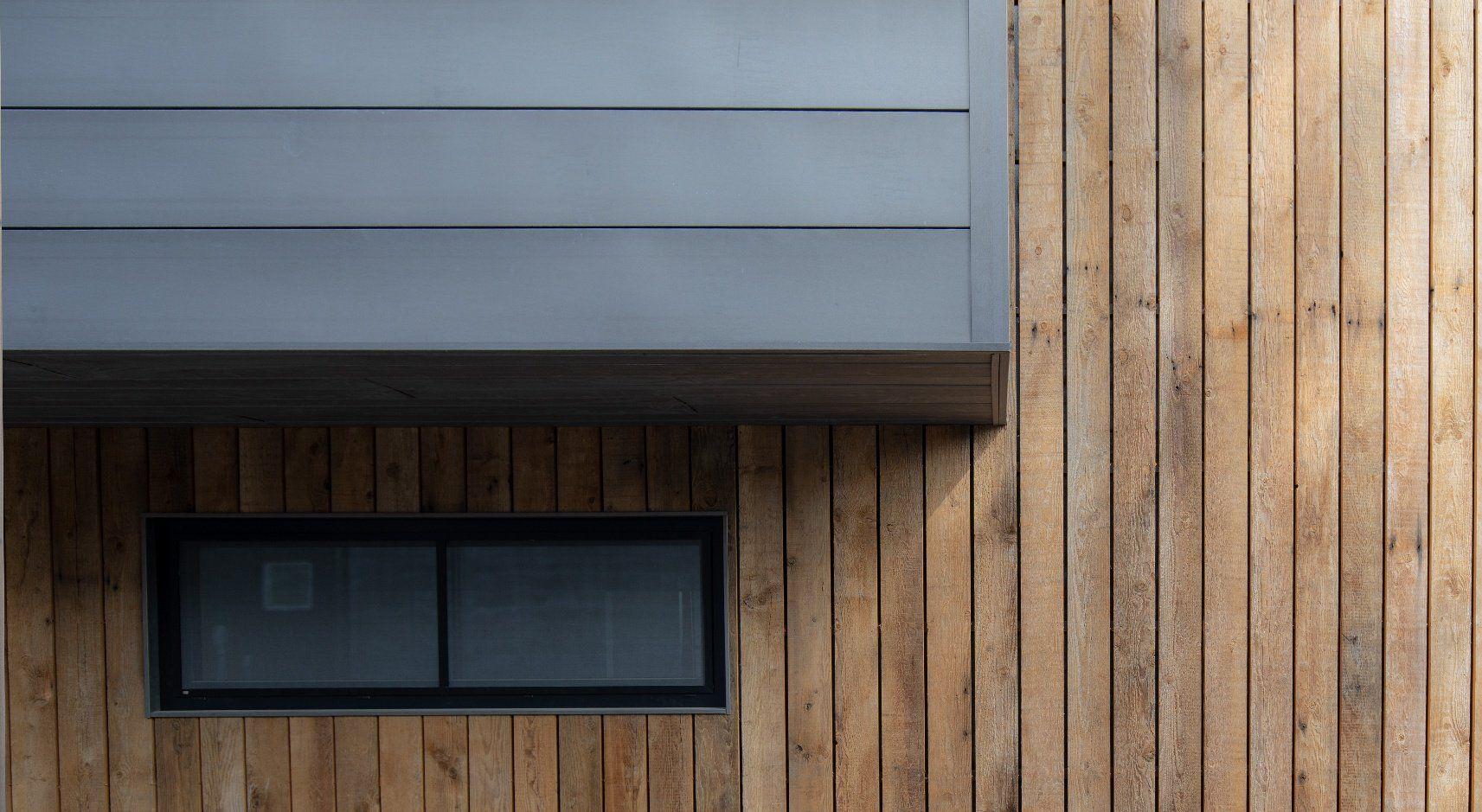 Using Metal Siding On A Modern Home Metal Siding Vertical Wood Siding Steel Siding